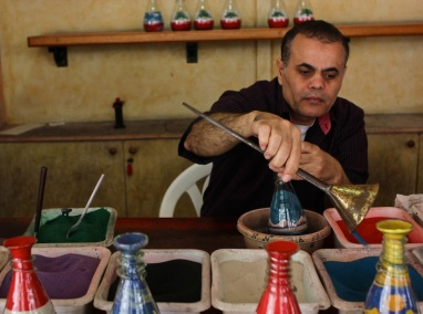 A craftsman from Alexandria, he has been doing this in Lebanon for 15 years, and can make an entire scene in a sand-art bottle in about three minutes.
