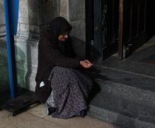 A beggar outside the Basilica of the Sacré Cœur in Montmartre.