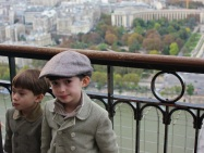 Little boys on the top of the Eiffel Tower for the first time.