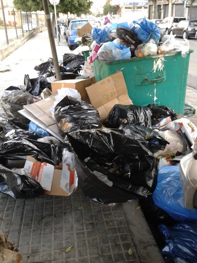 Trash spills out of an open dumpster in Mar Mikhael, Beirut, Lebanon.