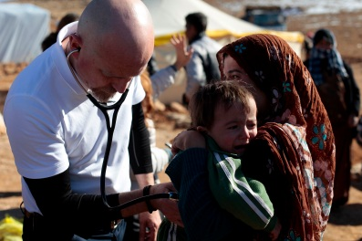 Dr. Batley examines a two year old boy from Al Qusair who has a harsh cough. Tuberculosis is a fear for the Syrian refugees in Arsal do to their unhygienic conditions and lack of aid and medical care. Photo by Omar Alkalouti.