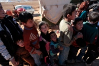 Syrian children line up for donations. Photo by Omar Alkalouti.