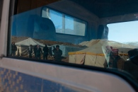 Window reflection of a vehicle that was embarking to the near by Syrian border on its way to Damascus. Photo by Omar Alkalouti