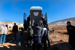 The Lebanese for Syrians donated portable toilets the the camp in hopes of better hygiene for the displaced syrians living there. Photo by Omar Alkalouti.