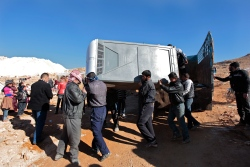Portable toilets are unloaded off trucks donated by private Lebanese citizen through Lebanese for Syrians. Photo by Omar Alkalouti.