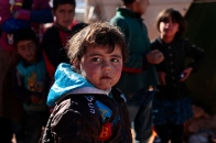 A young Syrian boy that fled two months ago with his mother from the town of Al Qusair after fighting broke out between the Syrian army and Opposition groups. The town is a strategic border town used for transporting supplies and weaponry for opposition groups. The boy and his family now live in a tent un an unregistered refugee camp between the borders of Lebanon and Syria. They can not afford to live in the near by town of Arsal land plots and housing has gone up tremendously since the influx of Syrian displaced that started over a year ago. Photo by Omar Alkalouti.